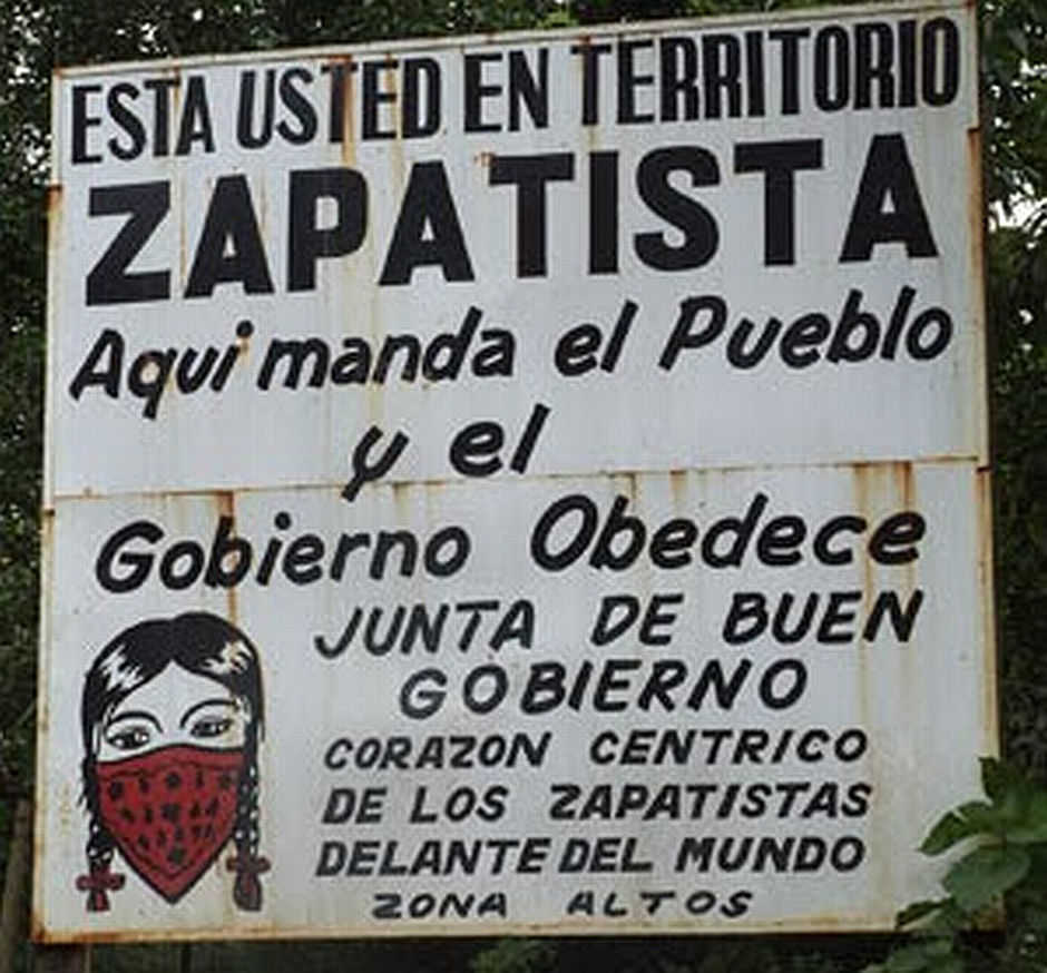"Sign: "" You are in Zapatista Territory. Here the people lead and the good government obeys. Central Zapastista Heart of the Highlands zone"""