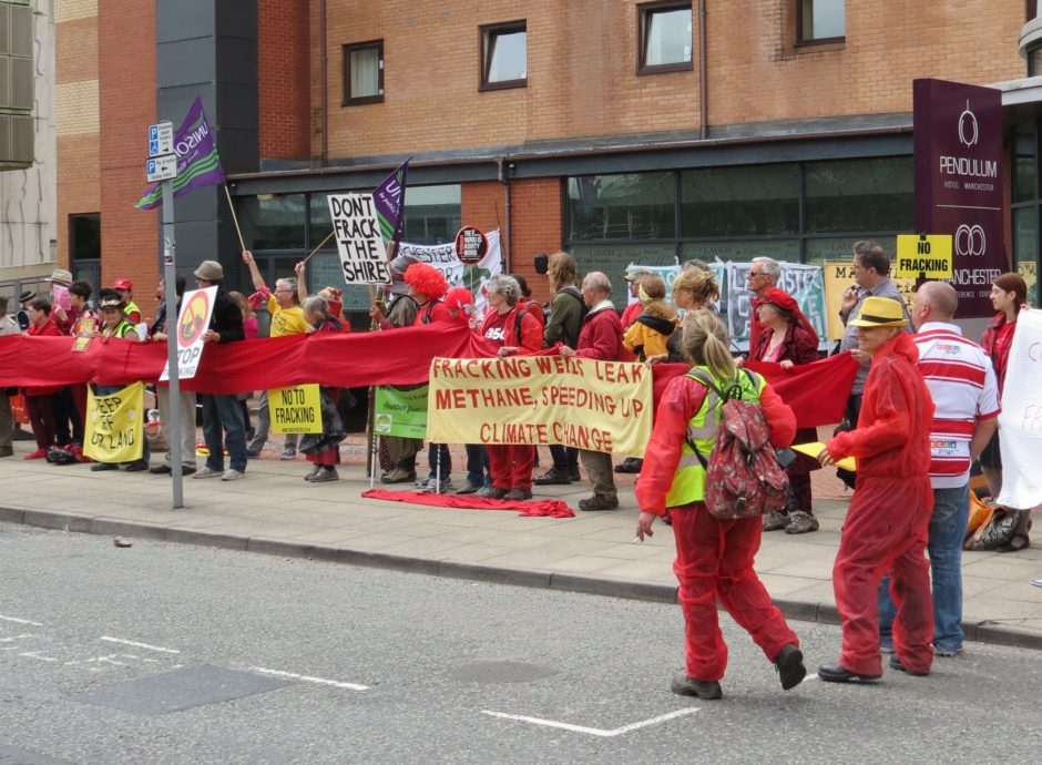 Anti-fracking protesters outside the Manchester Oil and Gas Summit in July 2016. PHOTO: Netpol