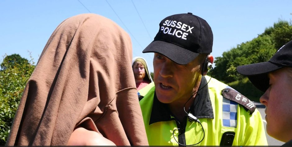 Sussex Police officer argues with protester