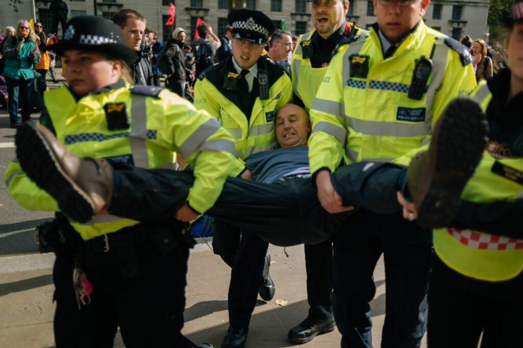 Protester arrested during Extinction Rebellion protests in London, October 2019